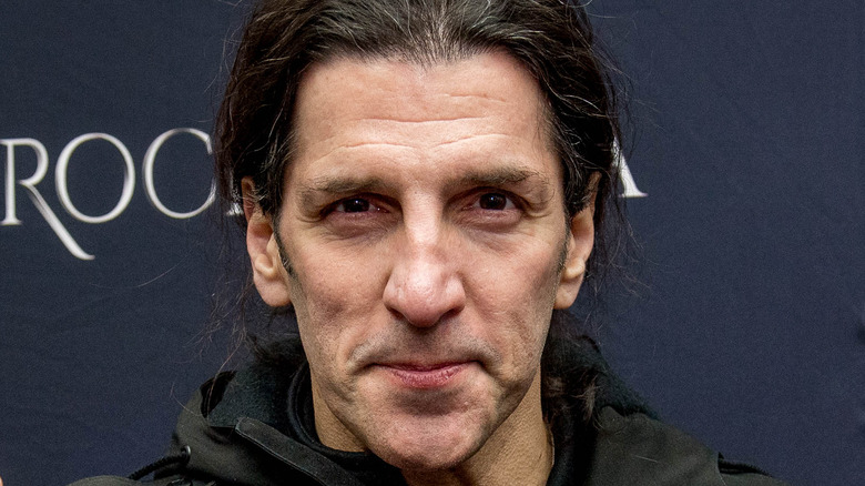 Frank Bello posing at event