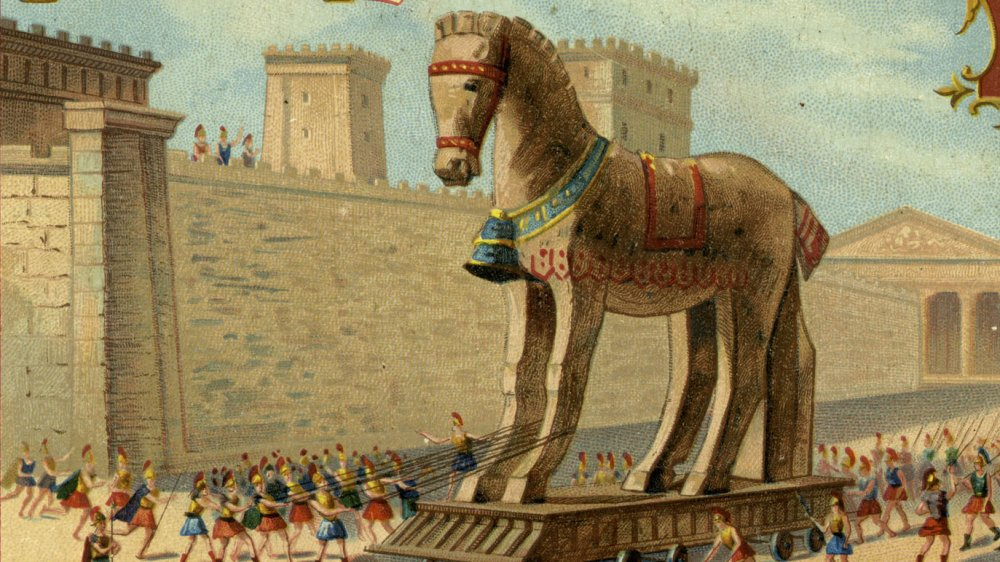 The Trojan Wars: The Wooden Horse is led into the town - from engraving published 1892.