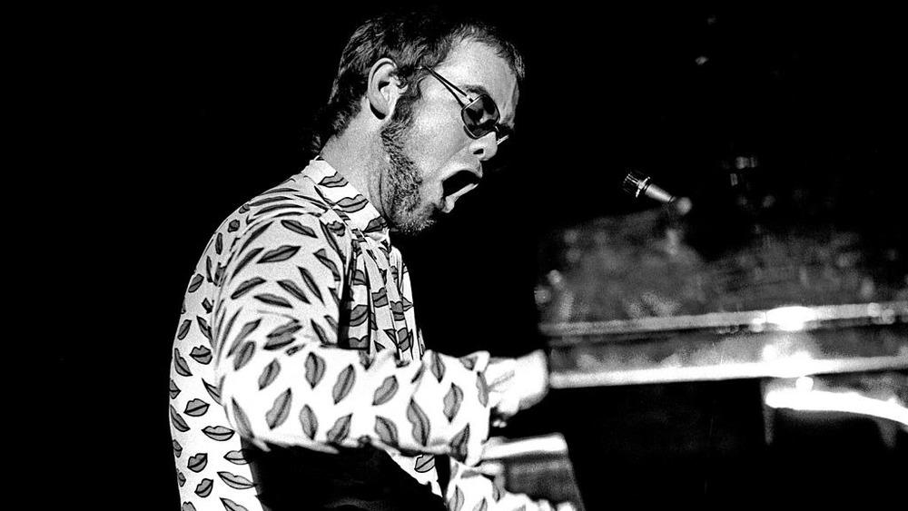 Elton John performing in concert