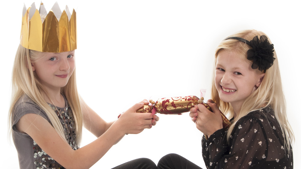 Two girls with Christmas cracker