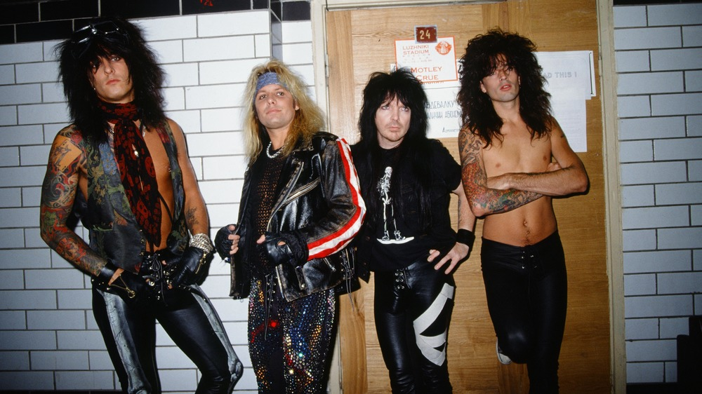 Mötley Crüe leaning up against a wall, 1989. L-R: Nikki Sixx, Vince Neil, Mick Mars, Tommy Lee.