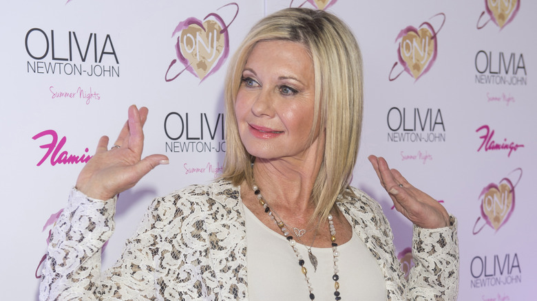 Olivia Newton-John with hands in air