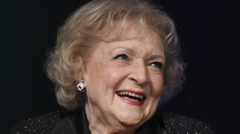 Betty White laughs