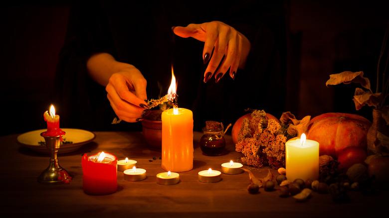 hands lighting candles
