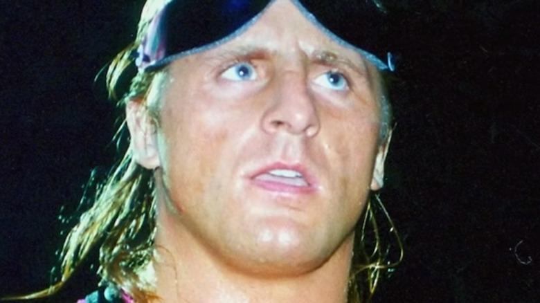 Bret Hart smiles in ring