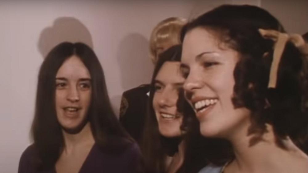 Susan Atkins, Patricia Krenwinkel, and Leslie Van Houten singinging