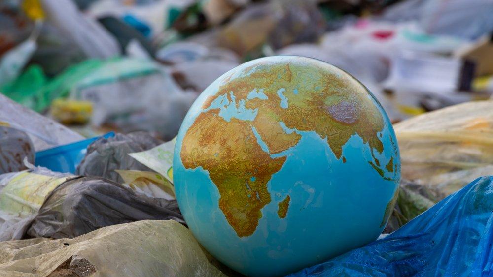 earth globe in garbage