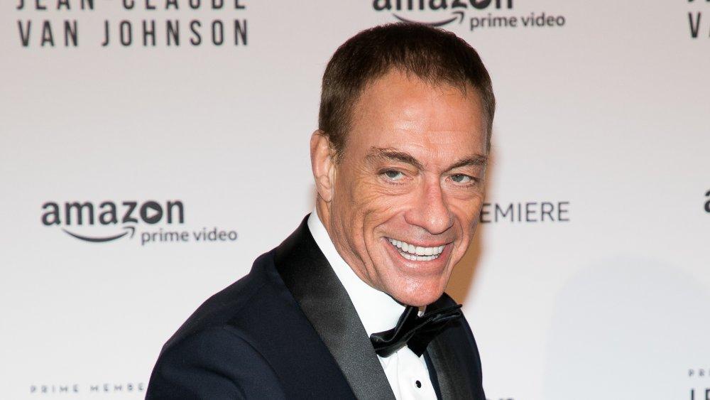 Jean Claude Van Damme posing in a suit