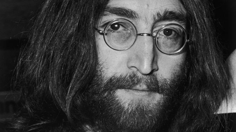 John Lennon wearing glasses