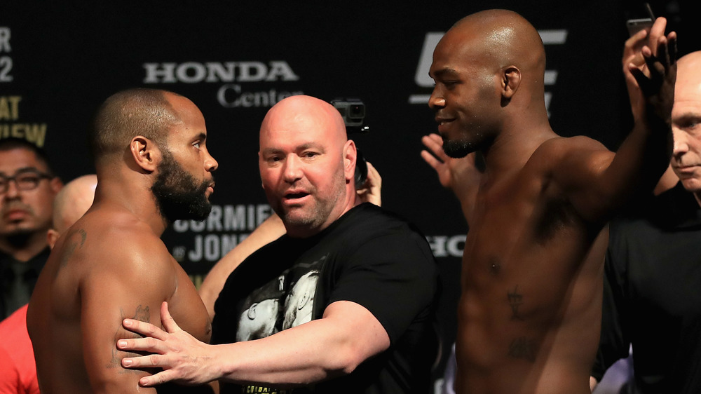 Daniel Cormier and Jon Jones are held back by UFC president Dana White during weigh-ins for UFC 214.