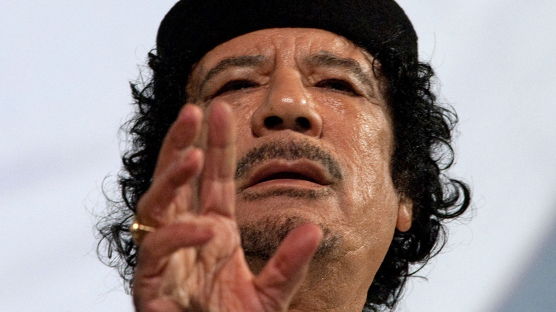 Muammar Gaddafi gesturing