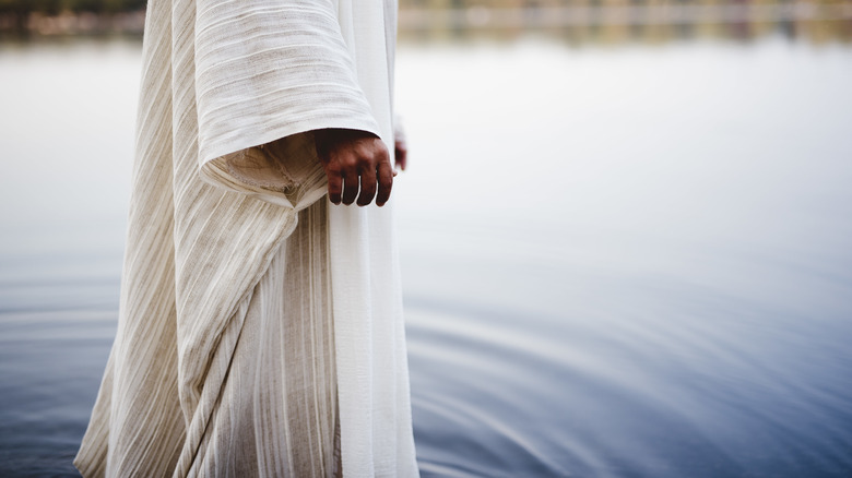 Jesus walking into water