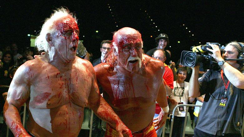 Ric Flair and Hulk Hogan bleeding from their faces