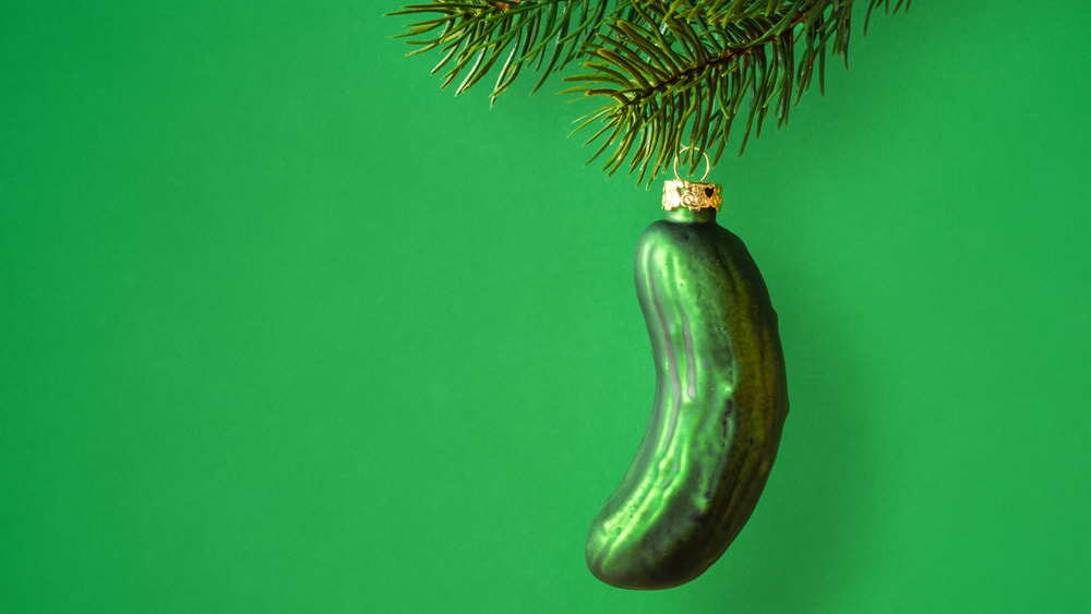 A rather obviously hidden Christmas pickle waits to be found