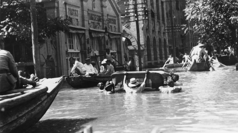 People traversing streets on boats