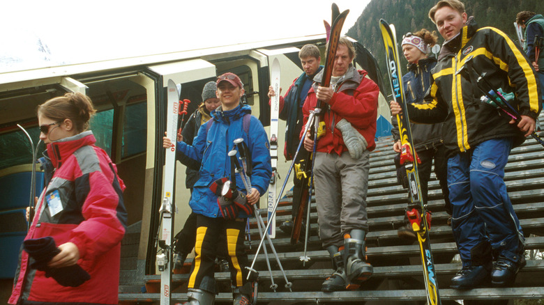 Skiers and cable car