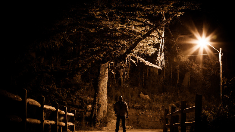 Creepy Man Standing in a Desolate Area at Dark