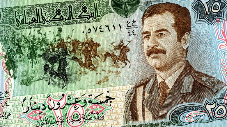 Iraq banknote featuring Saddam Hussein