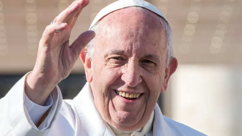 Pope Francis smiles and waves