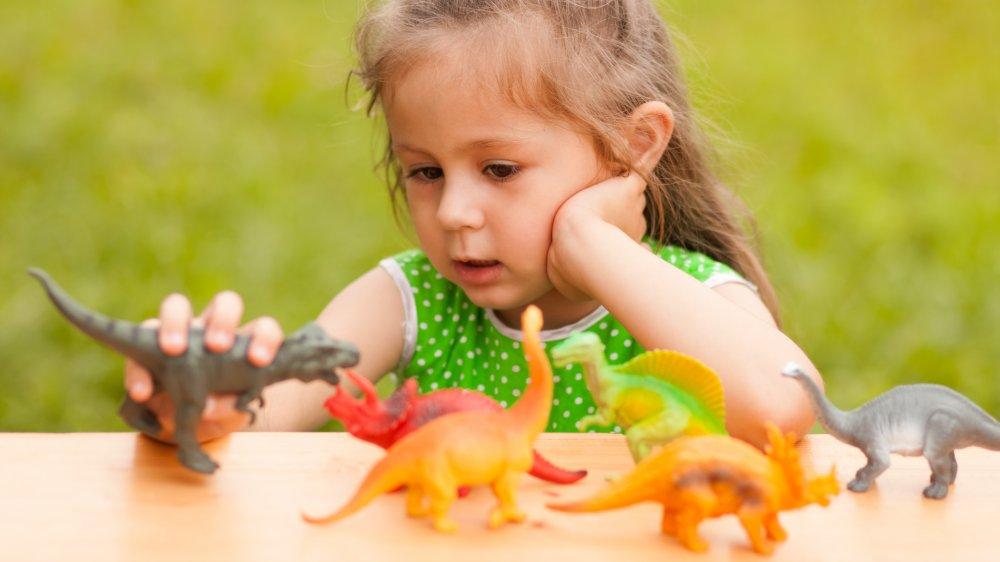 toy dinosaur little girl