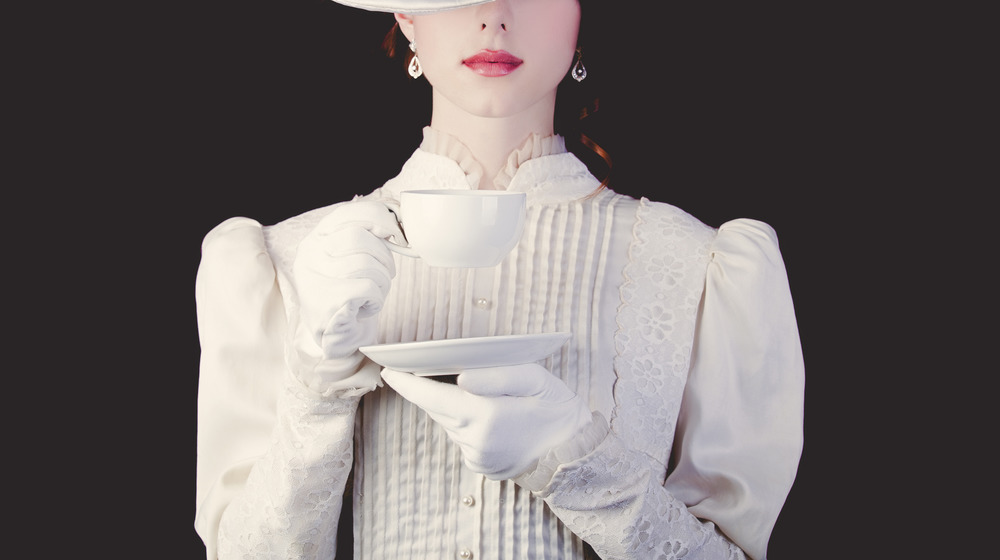 Woman with teacup and saucer