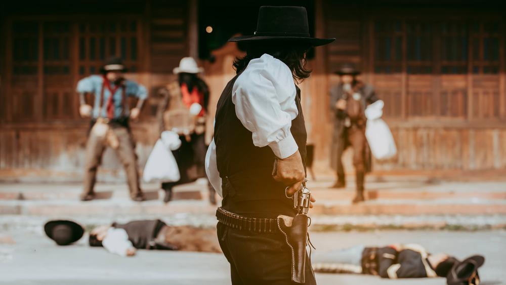 old west gunslinger with hand on gun