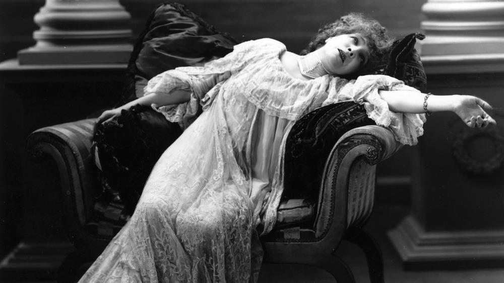 woman lying in chair