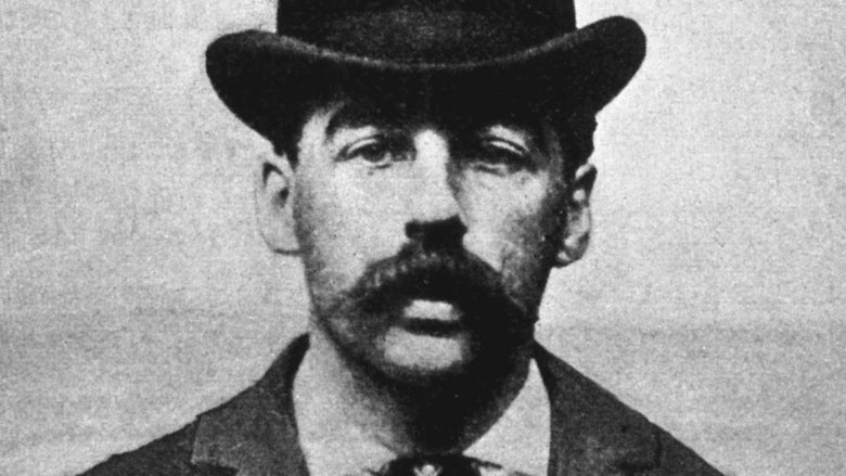 HH Holmes wearing hat