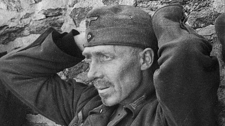 Surrendering Germans receive treatment notice by American, 1942, rec