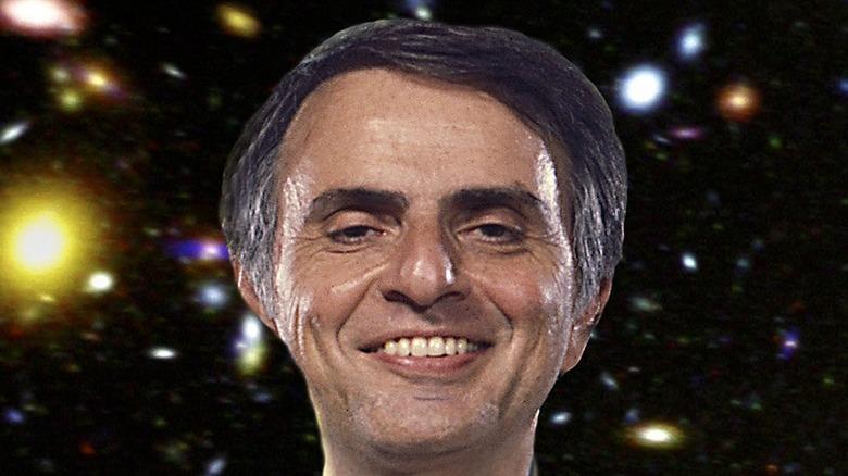 Carl Sagan smiling stars background