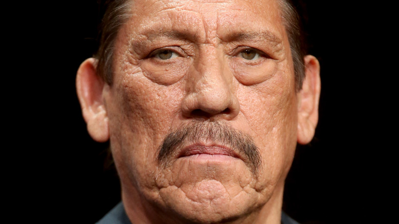 Danny Trejo, staring and unsmiling