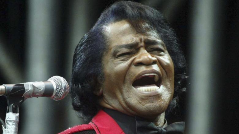James Brown singing at mic