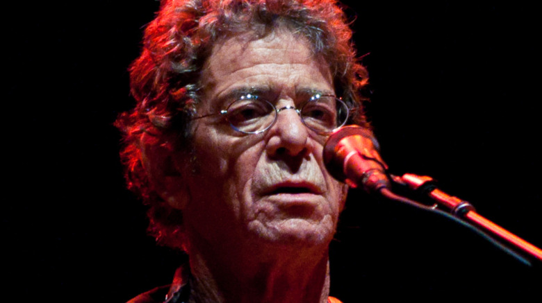 Lou Reed performing with guitar