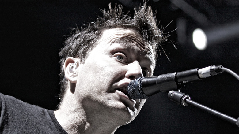Mark Hoppus performing on stage