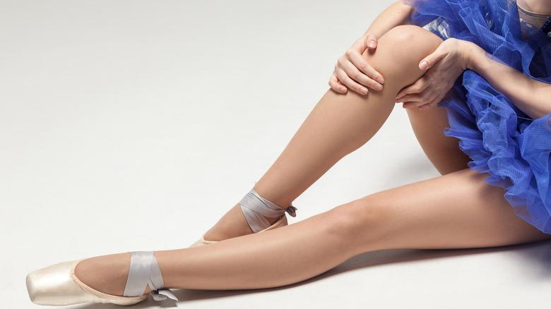 A dancer holding her knee