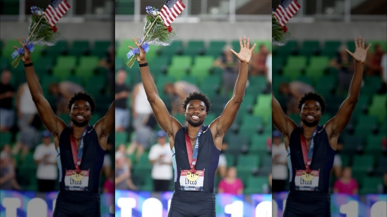 Noah Lyles with arms raised