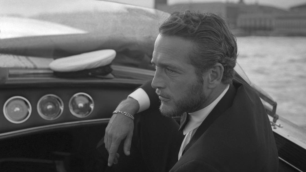 Paul Newman sitting on boat