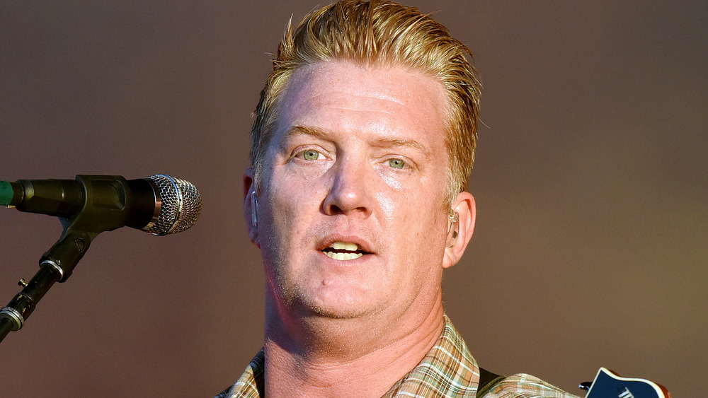 Josh Homme of Queens of the Stone Age at mic