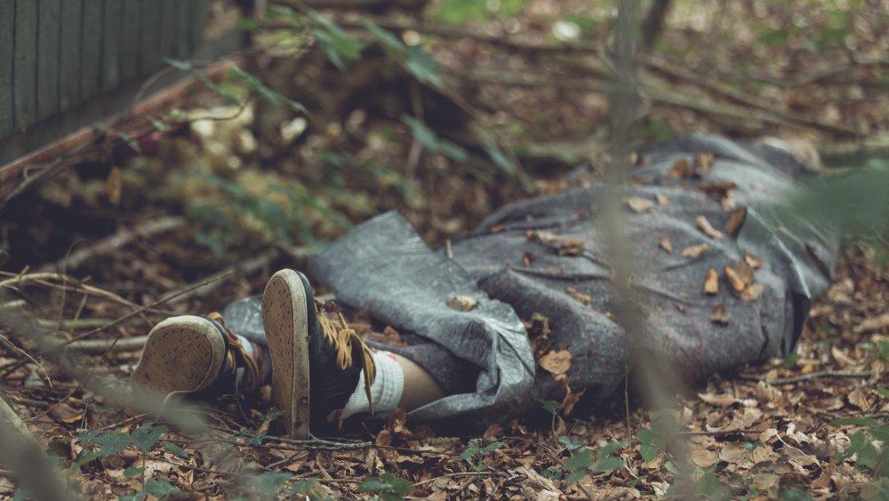 Dead body wrapped in tarpulin
