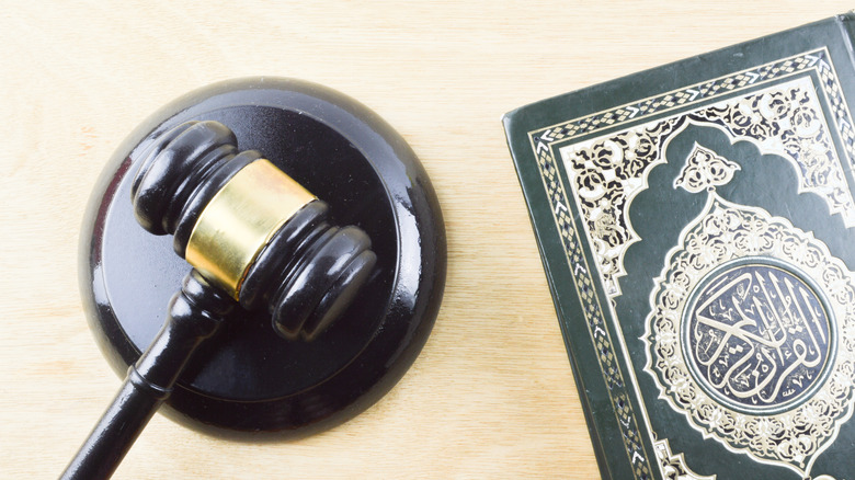 The Quran next to a law gavel