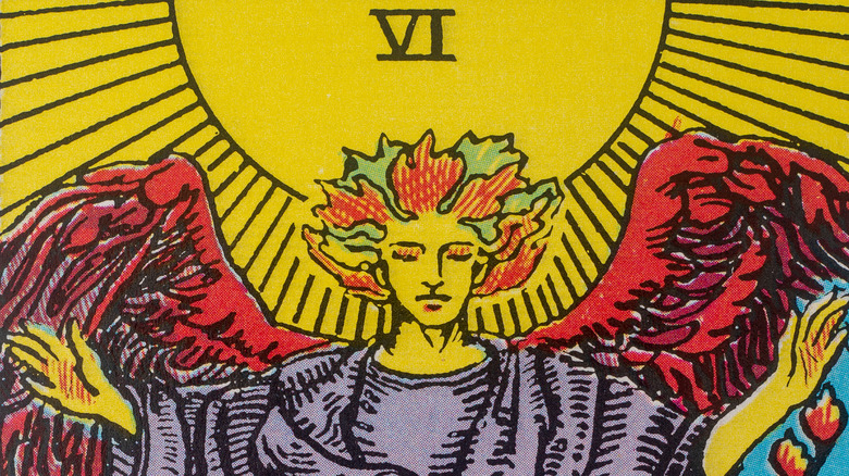 Tarot cards with candles