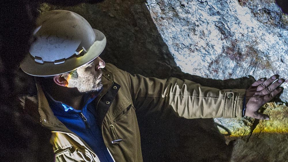 Miner works in dark tunnel