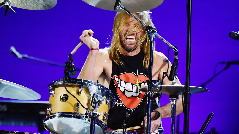 Taylor Hawkins plays the drums