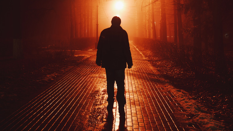 a person walking through fog