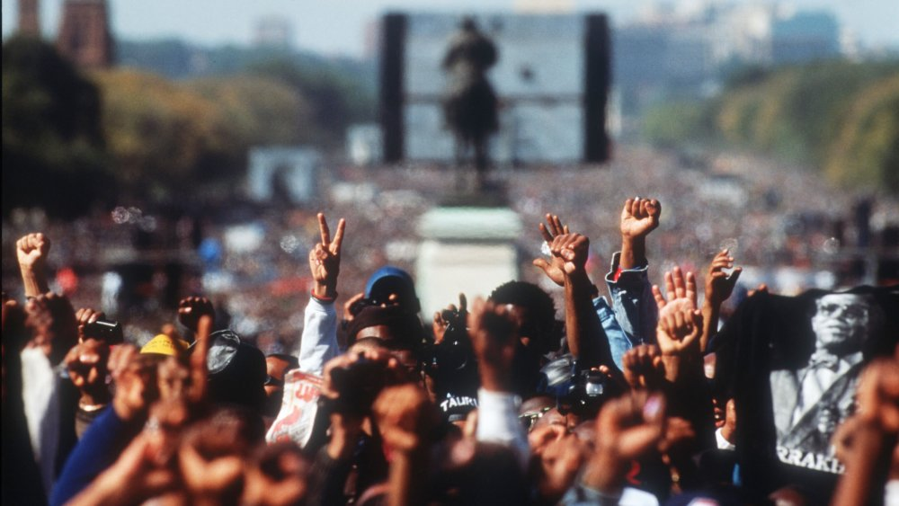Crowds of black Americans gather at the Washington Mall for the Million Man March in 1995