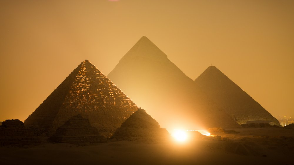 The Pyramids of Giza standing brilliantly in the dusk of Egypt