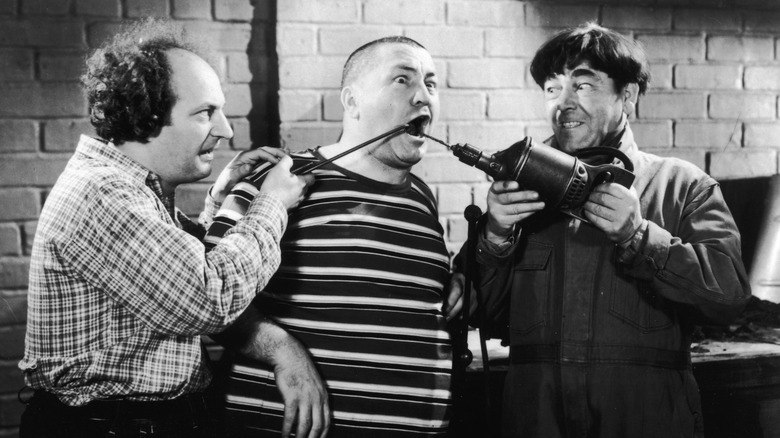 The Three Stooges perform some amateur dentistry.