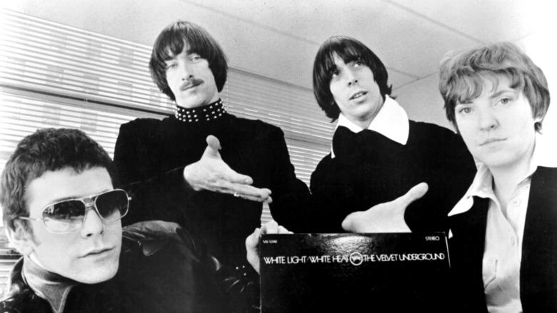 The Velvet Underground pointing to their album