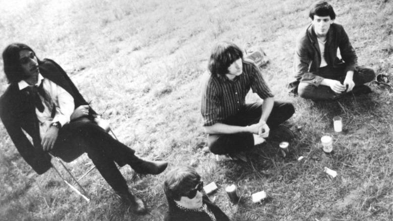 The Velvet Underground sitting on the ground