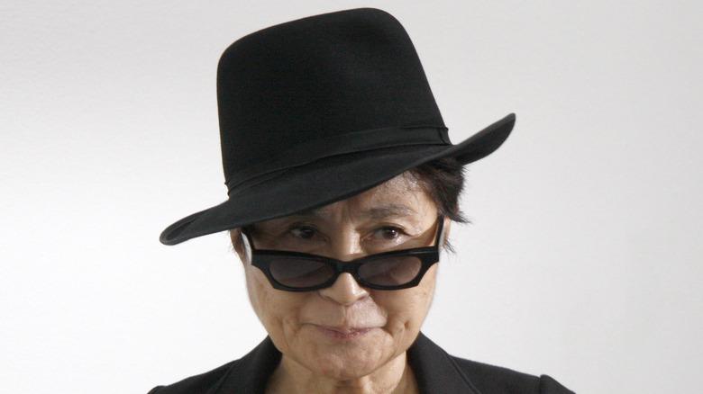 Yoko Ono in hat and sunglasses